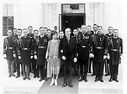 President and Mrs Coolidge with military aides, just after they assisted in a New Year reception, posed outside the White House 1927 Jan. 1
