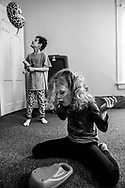 """Phoenix and her brother Taven play in her bedroom. Both siblings fall on the Autism Spectrum and are often in their own worlds. """"They see things that other people can't and they see things that are funny and neat that other people don't see. I just love that about them- they don't see the world in black and white. They see it as something completely different."""""""