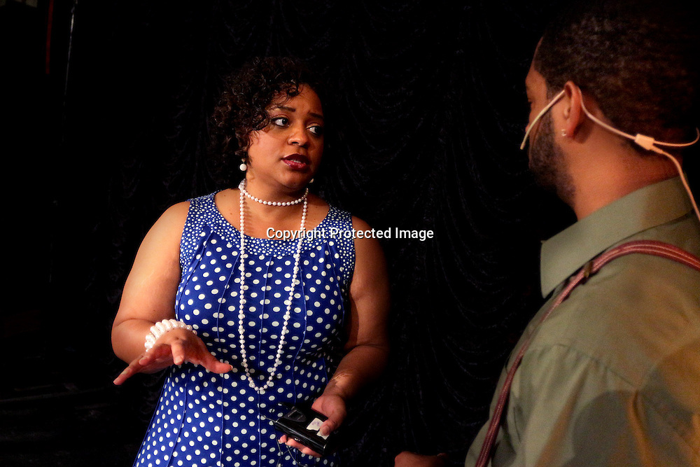 Joy Gregory, left, gives direction to Tracy Byrd before a performance of Smokey Joe's Cafe Sunday June 15, 2014 at the Scottish Rite Theater in Wilmington, N.C. (Jason A. Frizzelle)