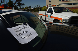 59537057 .A note of bomb threat is tagged on a police vehicle at the neighbourhood of the campus of the California State University Los Angeles (CSULA) in Los Angeles, April 18, 2013. The campus of the California State University Los Angeles (CSULA) is being evacuated Thursday due to a bomb threat. The CSULA announced the evacuation around noon, through loud speakers on the campus and Twitter, as a precaution, but did not provide additional information. Most of students and staff have been evacuated., April 18, 2013,  Friday 19, April. Photo by: i-Images.UK ONLY