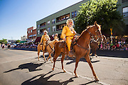 30 JUNE 2012 - PRESCOTT, AZ:  Members of the Bill Williams Mountain Men ride in the Prescott Frontier Days Rodeo Parade. The Bill Williams Mountain Men is a group of western reenactors named after Bill Williams, credited with being the founder of the northern Arizona city of Williams. The parade is marking its 125th year. It is one of the largest 4th of July Parades in Arizona. Prescott, about 100 miles north of Phoenix, was the first territorial capital of Arizona.    PHOTO BY JACK KURTZ