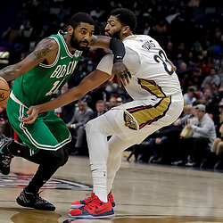 Nov 26, 2018; New Orleans, LA, USA; Boston Celtics guard Kyrie Irving (11) drives past New Orleans Pelicans forward Anthony Davis (23) during the second half at the Smoothie King Center. Mandatory Credit: Derick E. Hingle-USA TODAY Sports