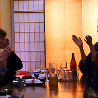 Asia, Japan, Kyoto. Geisha entertaining dinner guests.
