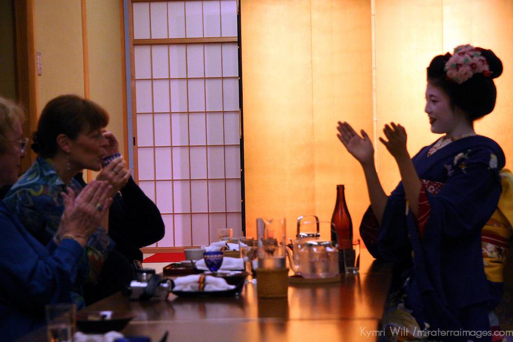 Asia, Japan, Kyoto. Geisha entertaining dinner guests.