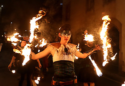 Members of ScotlandÕs pioneering Celtic Fire Theatre company, PyroCeltica, in full Highland Warrior apparel with flaming claymores and fire staffs leading a torchlight procession down the Royal Mile during Edinburgh Hogmanay celebrations.