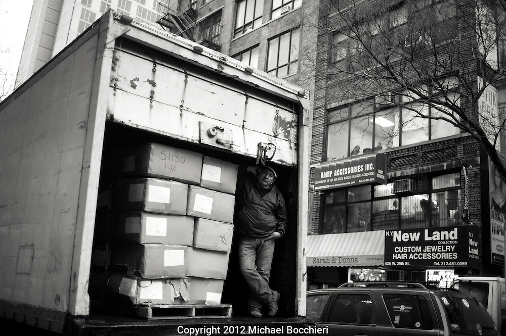 NEW YORK, NY - February 16:  A man stands in a truck next to boxes on February 16, 2012 in NEW YORK, NY.  (Photo by Michael Bocchieri/Bocchieri Archive)