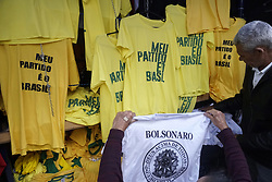 October 6, 2018 - SãO Paulo, São Paulo, Brazil - SAO PAULO SP, SP 06/10/2018 BOLSONARO:On the eve of the election for the Brazilian Presidency, an important shopping center in São Paulo sells t-shirts and masks by Jair Bolsonaro.The candidate for the presidency of Brazil for the Social Liberal Party (PSL), Jair Messias Bolsonaro, is an old acquaintance of politics who became the hope of millions of Brazilians change the country. Born March 21, 1955, the military in the reserve began his political career in 1988, when he was elected as an alderman in Rio de Janeiro by the Christian Democratic Party (PDC). With a popular and extreme right-wing speech, Bolsonaro has become the hope of millions of citizens who see in him the solution to the problems of insecurity that exist in Brazil, although it is also the fear of his detractors, who consider him a threat to democracy. (Credit Image: © Cris Faga/ZUMA Wire)