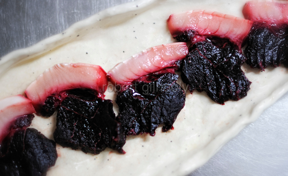 Slices of dolphin meat are displayed on a plate..Photographer: Robert Gilhooly...