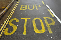 © Licensed to London News Pictures. 25/08/2014; Bristol, UK.  Bus Stop mis-spelt with paint as Bup Stop on Old Market in Bristol.  It is near the offices of the Bristol Post which was formerly owned by Bristol United Press (BUP).  The bus stop is temporary while the main bus stop is resurfaced following ruts in the tarmac caused by buses.<br /> Photo credit: Simon Chapman/LNP