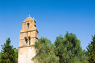 The stone belltower of Agios Constantinos in an olive tree grove, Paxos, Ionian Islands, Greece