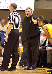 West Virginia Mountaineers head coach Bob Huggins argues a call against the Iowa State Cyclones during the first half at the WVU Coliseum.
