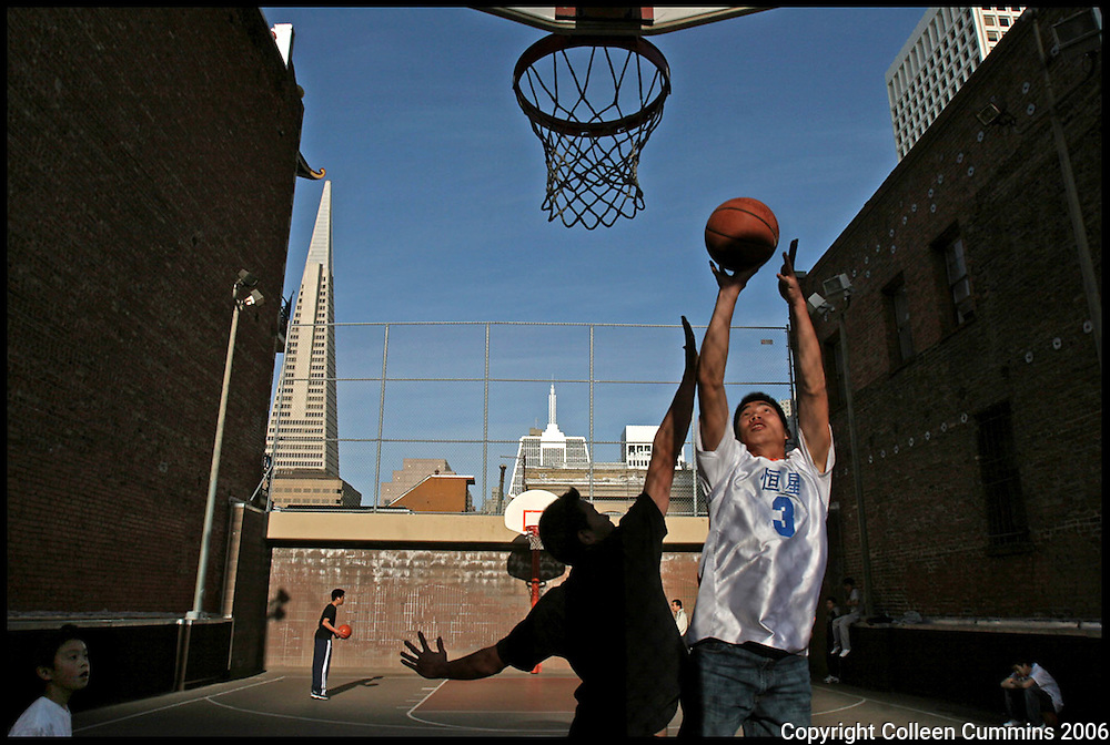 Heng Luo (center, white) at the Chinatown playground on Sacramento Street. Luo immigrated from China in January of 2006. He has always loved basketball and found that he could meet people in the neighborhood through the game.