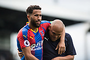 Andros Townsend (10) of Crystal Palace and Danny Young  during the Premier League match between Fulham and Crystal Palace at Craven Cottage, London, England on 11 August 2018.