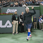 March 1, 2014, Indian Wells, California: <br /> John McEnroe enters the court during opening ceremonies for the newly constructed Stadium 2 at the Indian Wells Tennis Garden before the McEnroe Challenge for Charity presented by Esurance.<br /> (Photo by Billie Weiss/BNP Paribas Open)