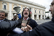Roma 25th feb 2015, leader and parliamentarians of Lega Nord party, demonstrates at Campidoglio's Square, demanding the resignation of mayor of Rome. In the picture Gianluca Peciola, left wing politician, protests against the demonstration