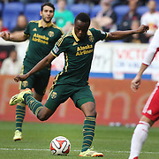 Steve Zakuani, (left), Portland Timbers, shoots during the New York Red Bulls Vs Portland Timbers, Major League Soccer regular season match at Red Bull Arena, Harrison, New Jersey. USA. 24th May 2014. Photo Tim Clayton