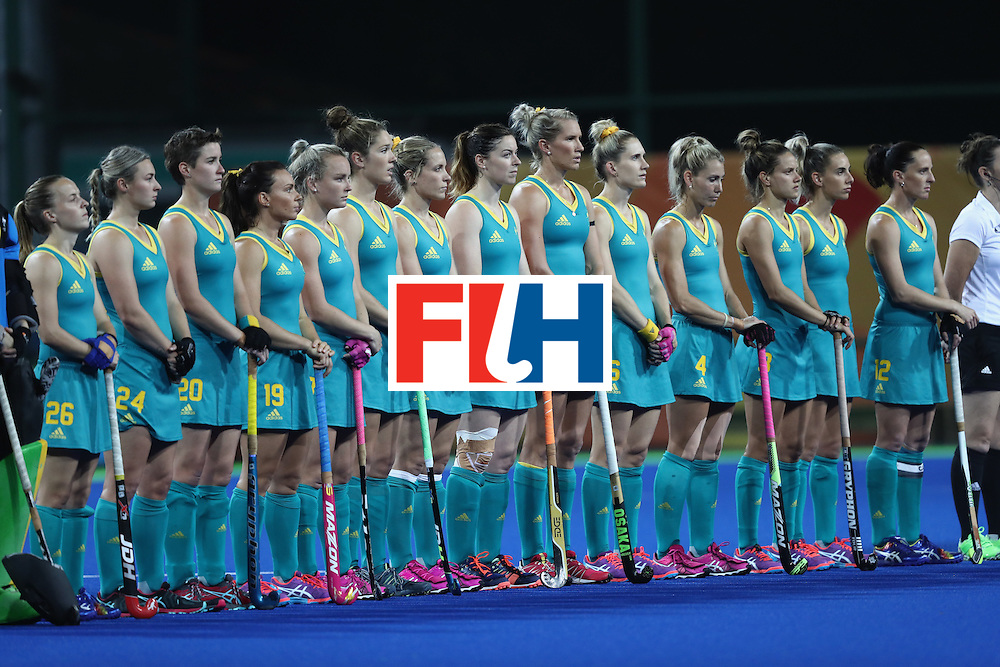 RIO DE JANEIRO, BRAZIL - AUGUST 13: The Australian team line up for the anthem before the Women's Pool B match between Australia and Japan on Day 8 of the Rio 2016 Olympic Games at the Olympic Hockey Centre on August 13, 2016 in Rio de Janeiro, Brazil.  (Photo by Phil Walter/Getty Images)