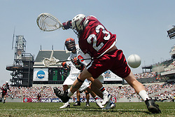Virginia's Danny Glading (9) gets a shot and goal past Massachusetts goalie Doc Schneider (23) in the Division I Lacrosse Finals Sunday, May 28, 2006 at Lincoln Financial Field in Philadelphia, PA. Virginia defeated Massachusetts 15-7 to win the championship.