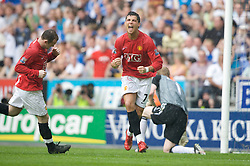 WIGAN, ENGLAND - Sunday, May 11, 2008: Manchester United's Cristiano Ronaldo celebrates after scoring another easily awarded penalty during the final Premiership match of the season against Wigan Athletic at the JJB Stadium. (Photo by David Rawcliffe/Propaganda)