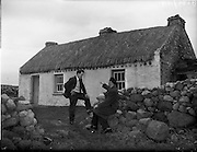 26-29/01/1960<br /> 01/26-29/1960<br /> 26-29 January 1960<br /> Gael-Linn Special at Gweedore and Teelin Co. Donegal. Image shows a Gael Linn representative chatting with a local outside a cottage.