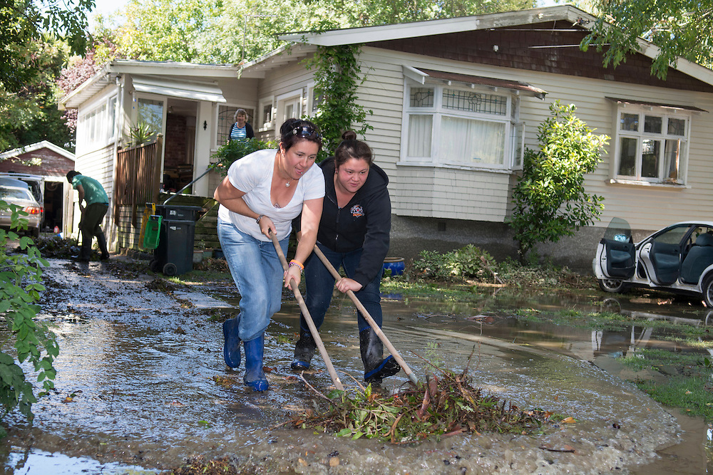 Merlinda Neels and Anna-Lisa Raika clear debris  from a property in Aynsley Terrace, Opawa after flooding from the Heathcote River, Christchurch, New Zealand, Thursday, 6 March, 2014.  <br /> Credit:SNPA / David Alexander