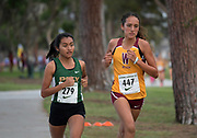 Nov 1, 2017; Long Beach, CA, USA; Leslie Diaz of Long Beach Poly (left) and Aliya Mesihovich of Long Beach Wilson lead the girls race during the Moore League cross country finals at Heartwell Park. Diaz won in a course record 17:21 and Mesihovich was second in 17:58.