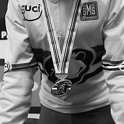 Marianne Vos and her World Championship medal. The distinctive striped white jersey is worn by the World Champion  in races up until the next championship race.
