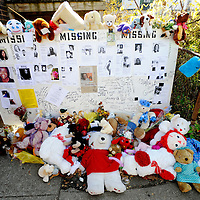 The memorial of stuffed animals and missing persons flyers on Sunday November 8, 2009. The memorial is across the street from the home of Anthony Sowell on Imperial Avenue in Cleveland  where 11 bodies have been discovered.
