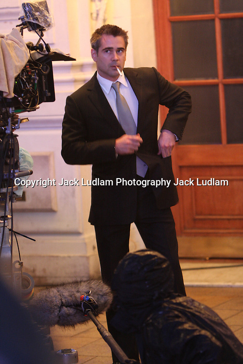 """PICS JACK LUDLAM MUST BYLINE      EXCLUSIVE  .COLIN FARRELL SHOOTING LONDON GANGESTER FLICK """"LONDON BOULAVARD""""  AT NITE IN THE POURING RAIN IN PICADILLY CIRCUS."""