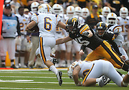 September 3, 2011: Iowa Hawkeyes linebacker Tyler Nielsen (45) tries to pull down Tennessee Tech Golden Eagles running back Adam Urbano (6) during the first half of the game between the Tennessee Tech Golden Eagles and the Iowa Hawkeyes at Kinnick Stadium in Iowa City, Iowa on Saturday, September 3, 2011. Iowa defeated Tennessee Tech 34-7 in a game stopped at one point due to lightning and rain.
