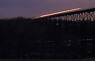 Salisbury Mills, NY - Lights from a passing train forms streaks across the Moodna Viaduct railroad trestle at dusk during a 20-second exposure on Jan. 1, 2010.