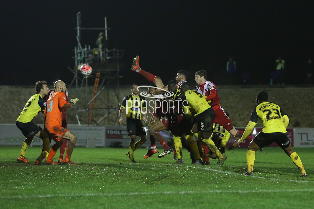 Juan Gotta of Whitehawk hits  the equalising goal 2-2 during the The FA Cup 2nd Round Replay match between Whitehawk FC and Dagenham and Redbridge at the Enclosed Ground, Whitehawk, United Kingdom on 16 December 2015. Photo by Phil Duncan.