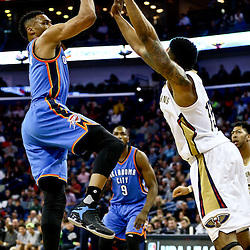 Feb 25, 2016; New Orleans, LA, USA; Oklahoma City Thunder guard Russell Westbrook (0) shoots over New Orleans Pelicans guard Jrue Holiday (11) during the first quarter of a game at Smoothie King Center. Mandatory Credit: Derick E. Hingle-USA TODAY Sports