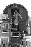 Ben at the entrance of his caravan, Glastonbury, Somerset, 1989