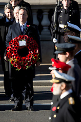 © London News Pictures. 11/11/2012. London, UK. British Prime Minister David Cameron holding a wreath during a Remembrance Day Ceremony at the Cenotaph on November 11, 2012 in London, United Kingdom. Photo credit: Ben Cawthra/LNP