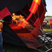 Pilots prepare to launch around rural Michigan near Battle Creek during the World Hot Air Ballooning Championships. Battle Creek, Michigan, USA. 21st August 2012. Photo Tim Clayton