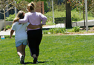 A mother and daughter walk to cool down after group exercise in the 10-week Shapedown Program at The Children's Hospital in Aurora, Colorado May 29, 2010.  The program is part of the child and teen weight management program at the hospital. REUTERS/Rick Wilking (UNITED STATES)