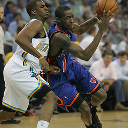 New York Knicks guard Jamal Crawford #11 drives past New Orleans Hornets guard Chris Paul #3 in the first quarter of their NBA game on April 4, 2008 at the New Orleans Arena in New Orleans, Louisiana.