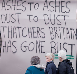 © Licensed to London News Pictures. 08/03/2013.Goldthorpe, UK. Residents of Goldthorpe near Barnsley come together to celebrate the death of Barrenness Thatcher on the day of her funeral in London. Banners  line the building fronts as residents shout anti Thatcher Chants.  Photo credit : Tom Maddick/LNP