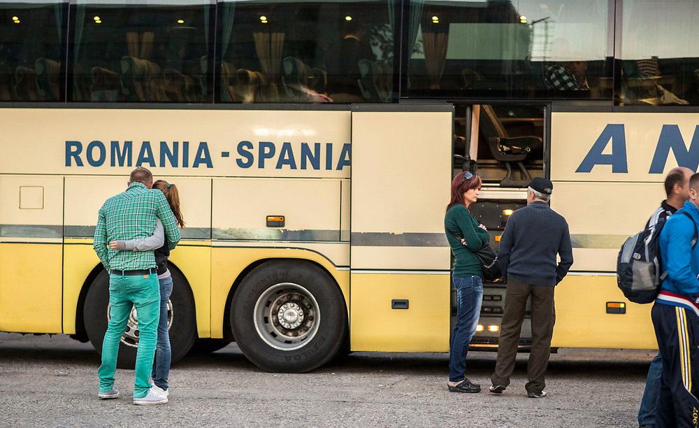 People embarking a bus leaving to Spain. Nasaud, Romania