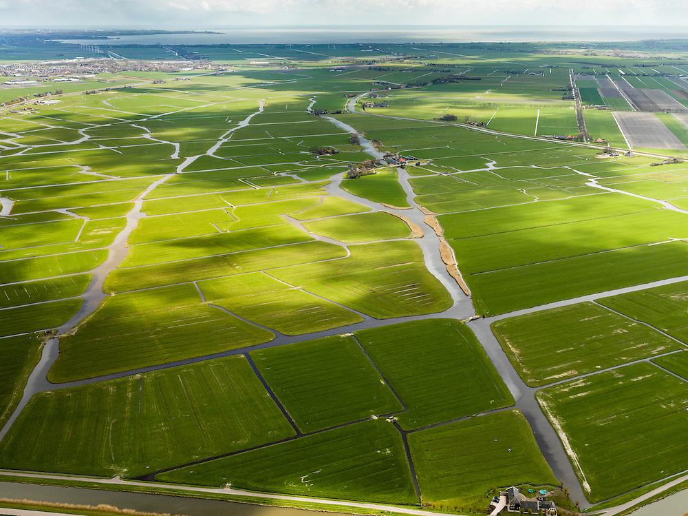 Nederland, Noord-Holland, Gemeente Schermer, 16-04-2012; Polder Mijzen, gezien van de Schermerringvaart, rechtsboven De Beemster, IJsselmeer aan de  aan de horizon. De polder is een aardkundig monument doordat het laagveen (mosveen) nagenoeg onaangetast is. .Polder Mijzen, a geological monument, the bog (moss) is virtually untouched.luchtfoto (toeslag), aerial photo (additional fee required);.copyright foto/photo Siebe Swart