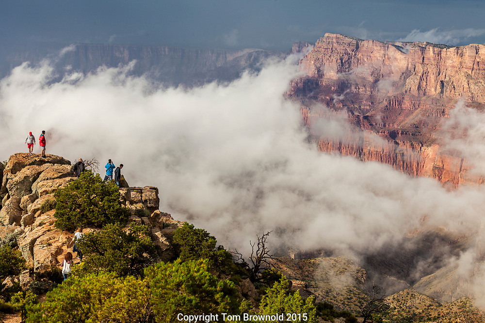 "Tourists ""Wowed"" by approaching storm clouds gathering in the Canyon below and to the north of the Desert Palisades."