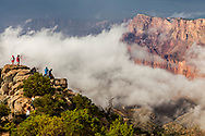 """Tourists """"Wowed"""" by approaching storm clouds gathering in the Canyon below and to the north of the Desert Palisades."""