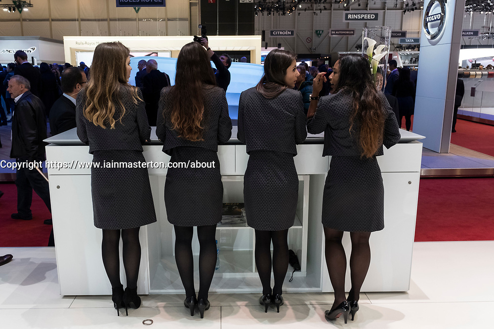 Ladies on Jaguar Land Rover stand at 87th Geneva International Motor Show in Geneva Switzerland 2017