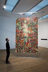 © Licensed to London News Pictures. 13/11/2012. London, UK. A Tate Modern employee views Jutta Koether's 'Mad Garland (Plank Paintings Set #3)' (2011) at the press view for a new exhibition at the Tate Modern in London today (13/11/12) . The exhibition, 'A Bigger Splash: Painting After Performance', takes a look at the relationship between painting and performance, bringing together the works of over 40 artists, including Jackson Pollock and Cindy Sherman, and runs from the 14th of November 2012 to the 1st of April 2013.  Photo credit: Matt Cetti-Roberts/LNP