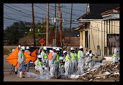 21st, December 2005. New Orleans, Louisiana. City contractors start thje long and arduous task of clearing the trash strewn streets of the  9th Ward long after the  flood from Hurrican Katrina subsided.