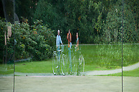 Middleheim Sculpture Park, Antwerp, Belgium - Reflection of three cyclists in a glass scultpure