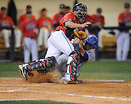 Florida's Matt den Dekker (17) scores as the ball gets past Mississippi catcher Taylor Hightower at Oxford-University Stadium on Friday, March 26, 2010 in Oxford, Miss. Ole Miss won 3-2.
