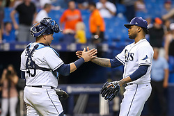 July 25, 2017 - St. Petersburg, Florida, U.S. - WILL VRAGOVIC   |   Times.Tampa Bay Rays catcher Jesus Sucre (45) high fives relief pitcher Alex Colome (37) after the game between the Baltimore Orioles and the Tampa Bay Rays at Tropicana Field in St. Petersburg, Fla. on Tuesday, July 25, 2017. The Tampa Bay Rays beat the Baltimore Orioles 5-4. (Credit Image: © Will Vragovic/Tampa Bay Times via ZUMA Wire)