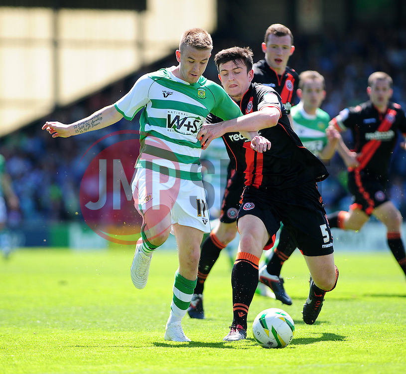 Yeovil Town's Paddy Madden is challenged by Sheffield United's Harry Maguire - Photo mandatory by-line: Dougie Allward/JMP - Tel: Mobile: 07966 386802 06/05/2013 - SPORT - FOOTBALL - Huish Park - Yeovil - Yeovil Town V Sheffield United - NPOWER LEAGUE ONE PLAY-OFF SEMI-FINAL SECOND LEG